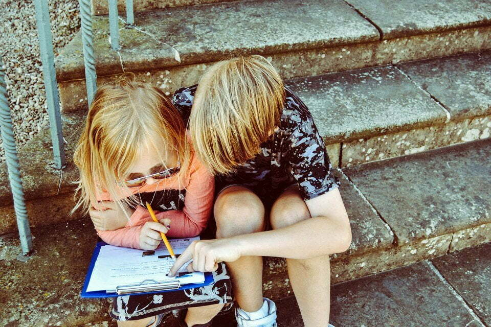 Social learning - Two children looking at a book together