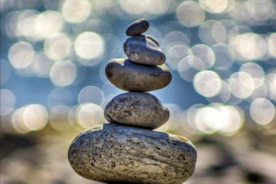 Stones balancing to suggest wellness - wellness should be part of the L&D agenda